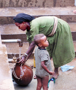 child with water container